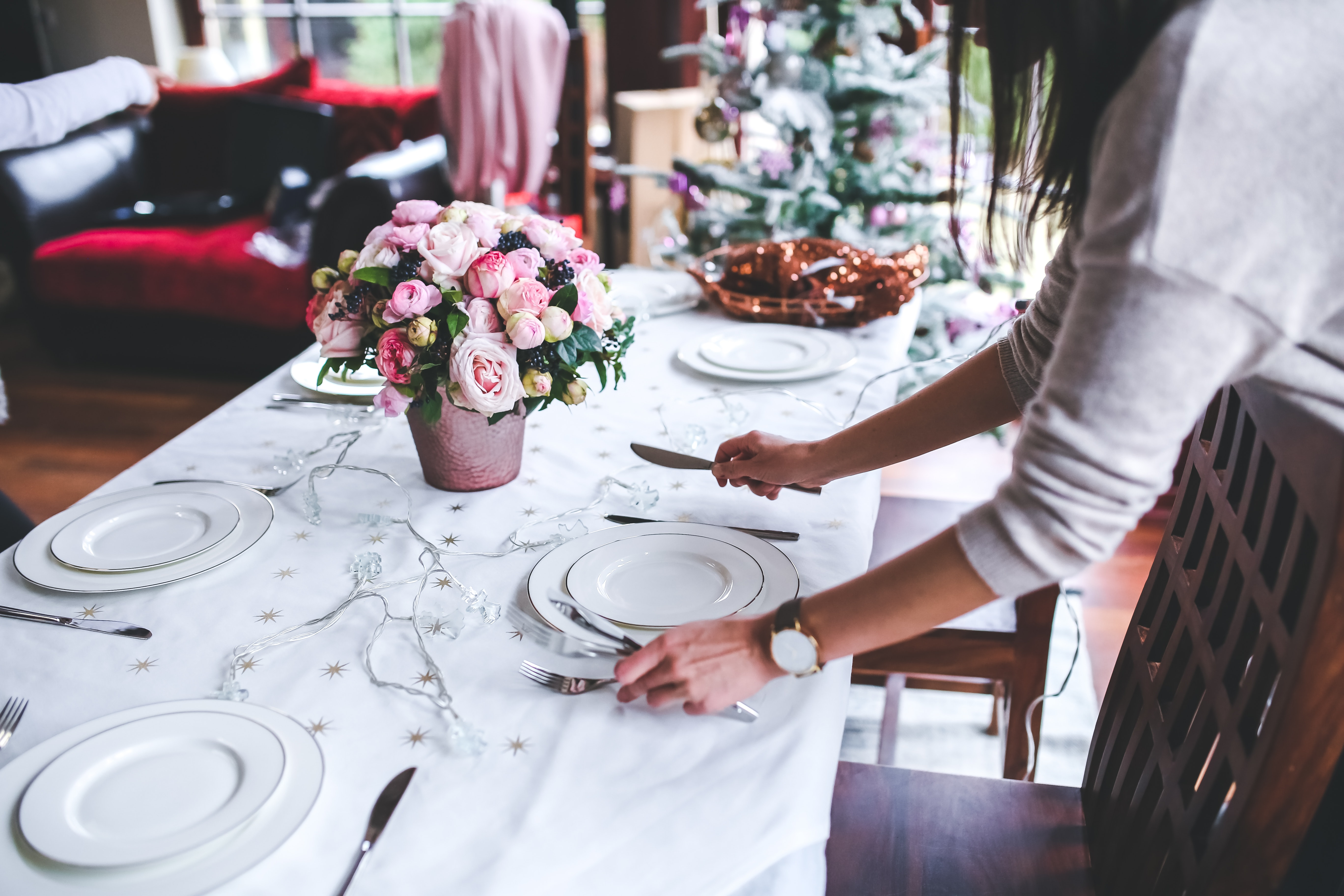 woman setting table for nice dinner