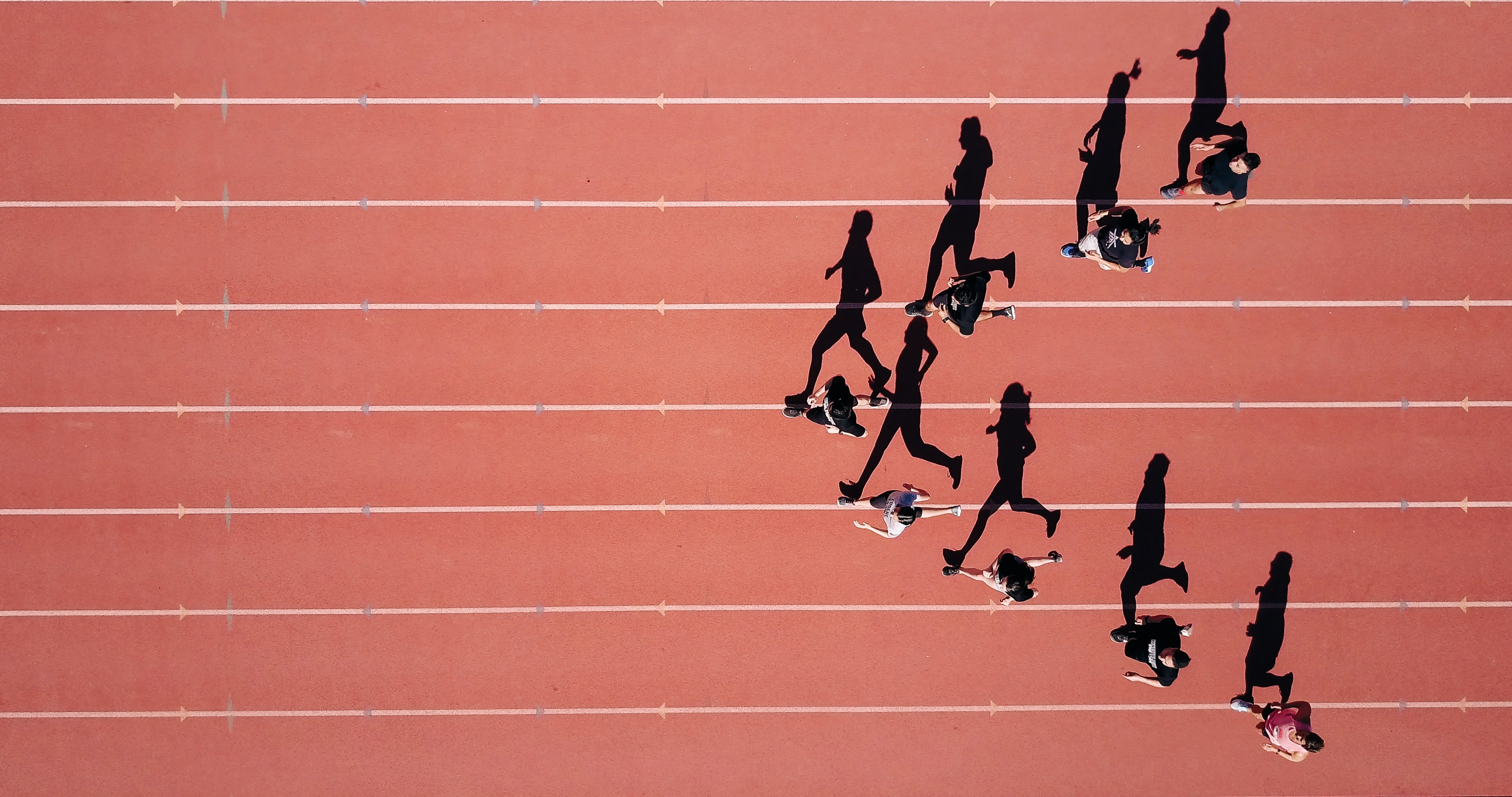 group running on track top-down view